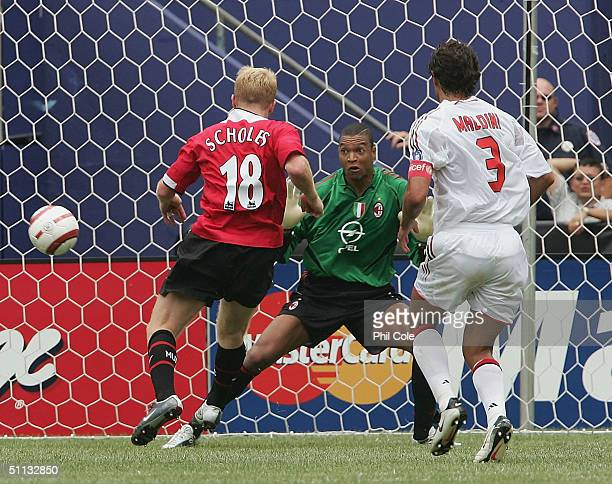 Paul Scholes of Manchester United scores during the Champions World Series at Giants Stadium July 31, 2004 in East Rutherford, New Jersey.