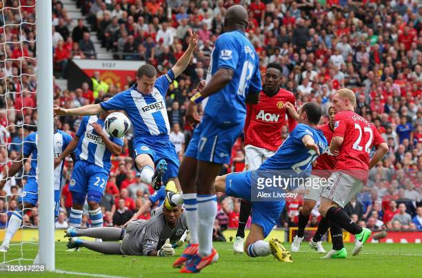 Paul Scholes of Manchester United scores the opening goal during the Barclays Premier League match between Manchester United and Wigan Athletic at...