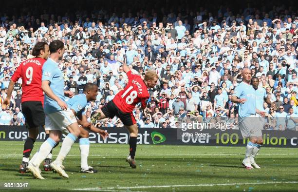 Paul Scholes of Manchester United scores their first goal during the Barclays Premier League match between Manchester City and Manchester United at...