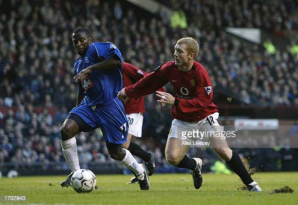 Paul Scholes of Manchester United tussles with Michael Johnson of Birmingham City during the FA Barclaycard Premiership match between Manchester...