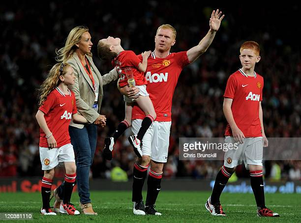 Paul Scholes of Manchester United waves to the fans with his wife Claire and children, Arron, Alicia and Aiden at the end of his Testimonial Match...