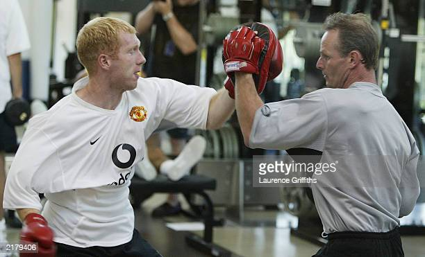 Paul Scholes of Manchester United works out in the gym with boxing gloves during their first training session of their American Tour on July 20 at...