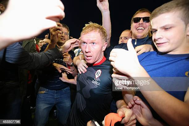 Paul Scholes of the Class of '92 XI is mobbed by fans at the end of the match between Salford City and the Class of '92 XI at AJ Bell Stadium on...