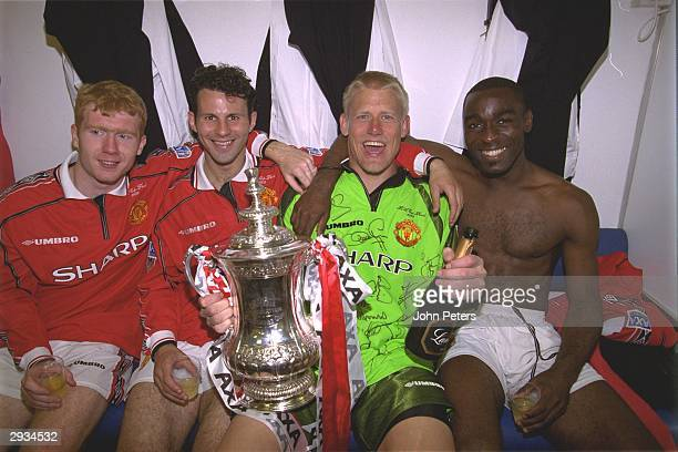 Paul Scholes, Ryan Giggs, Peter Schmeichel and Andy Cole of Manchester United celebrate in the dressing room after the FA Cup Final between...