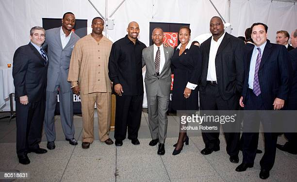 Paul Schulman of Brookfield Properties Kassim Osgood of the San Diego Chargers Marques Douglas of the Tampa Bay Buccaneers Chris Draft of the St...