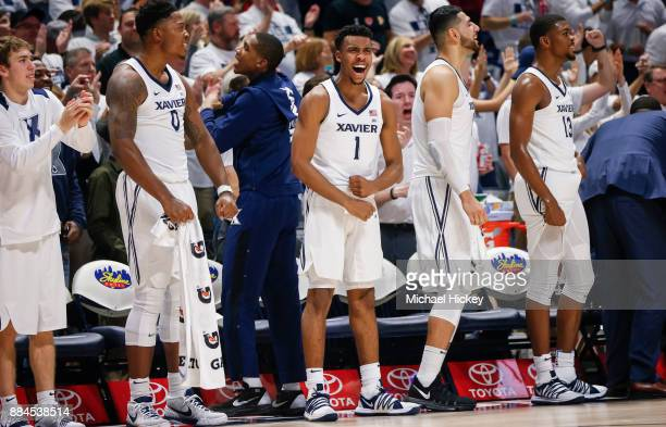 Paul Scruggs and members of the Xavier Musketeers celebrate during the game against the Cincinnati Bearcats at Cintas Center on December 2 2017 in...