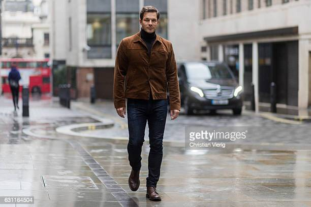 Paul Sculfor wearing a brown corduroy jacket dark denim jeans brown leather shoes during London Fashion Week Men's January 2017 collections at Lou...