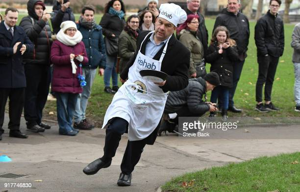 Paul Scully MP approachess the second corner in the annual Parliamentary Pancake Race in Victoria Tower Gardens on Shrove Tuesday on February 13 2018...