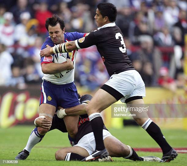 Paul Sculthorpe of Great Britain is tackled by Shontayne Hape of New Zealand during the XXXX Test match between Great Britain and New Zealand at...