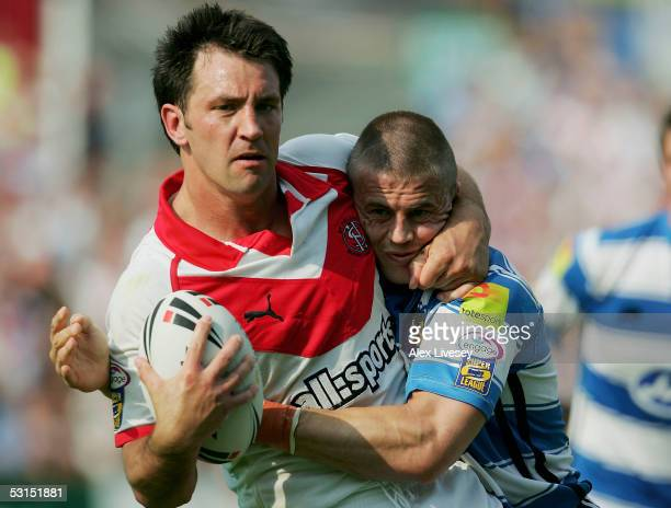 Paul Sculthorpe of St Helens holds off a challenge from Martin Aspinwall of Wigan Warriors during the Powergen Challenge Cup Quarter Final match...