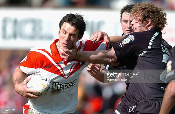 Paul Sculthorpe of StHelens hands off Gareth Carvell of Hull during the Powergen Challenge Cup Quarter Final match between St Helens and Hull FC at...