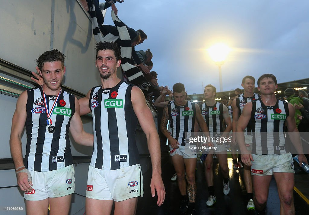 Paul Seedsman and Scott Pendlebury of the Magpies celebrate winning the round four AFL match between the Essendon Bombers and the Collingwood Magpies at Melbourne Cricket Ground on April 25, 2015 in Melbourne, Australia.
