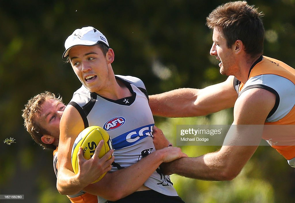 Paul Seedsman gets tackled during a Collingwood Magpies AFL training session at Gosch's Paddock on February 20, 2013 in Melbourne, Australia.