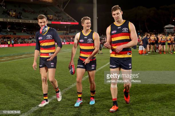 Paul Seedsman Matt Crouch and Josh Jenkins of the Crows celebrate their win during the 2018 AFL round 22 match between the Adelaide Crows and the...
