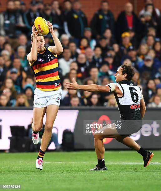 Paul Seedsman of the Adelaide Crows marks in front of Steven Motlop of Port Adelaide during the round eight AFL match between the Port Adelaide Power...