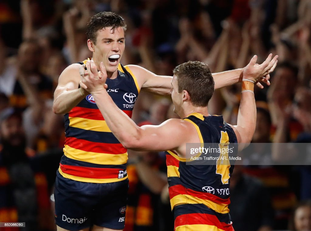 Paul Seedsman of the Crows (left) celebrates a goal with Josh Jenkins of the Crows during the 2017 AFL First Preliminary Final match between the Adelaide Crows and the Geelong Cats at Adelaide Oval on September 22, 2017 in Adelaide, Australia.