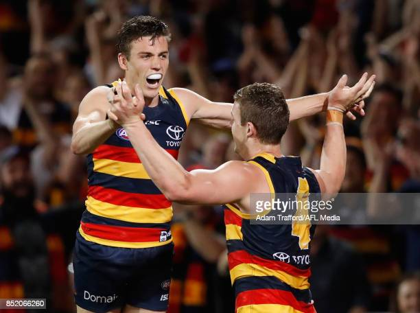 Paul Seedsman of the Crows celebrates a goal with Josh Jenkins of the Crows during the 2017 AFL First Preliminary Final match between the Adelaide...
