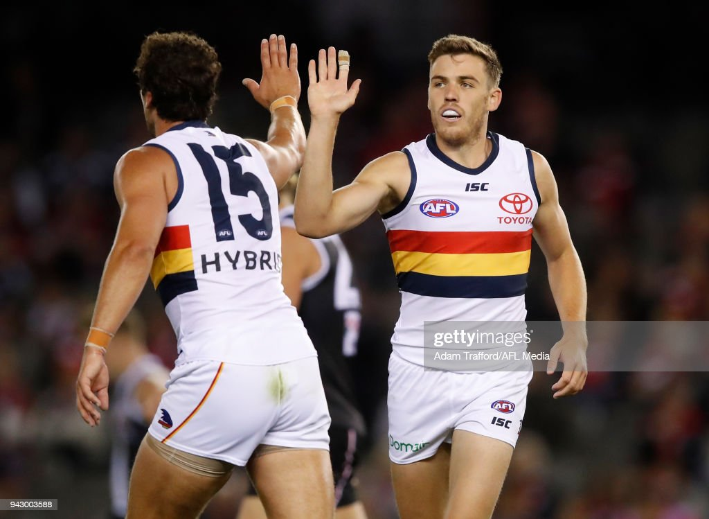Paul Seedsman of the Crows (right) celebrates a goal with Kyle Hartigan of the Crows during the 2018 AFL round 03 match between the St Kilda Saints and the Adelaide Crows at Etihad Stadium on April 7, 2018 in Melbourne, Australia.