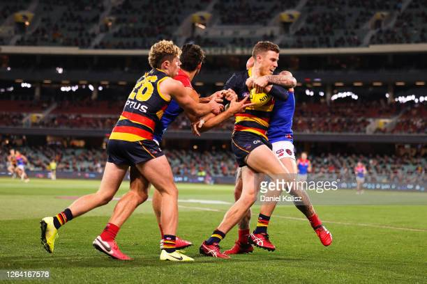 Paul Seedsman of the Crows competes for the ball during the round 10 AFL match between the Adelaide Crows and the Melbourne Demons at Adelaide Oval...