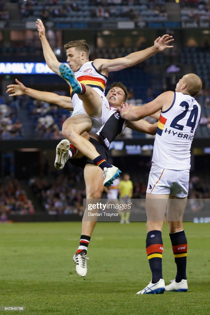Paul Seedsman of the Crows is bumped under the flight of the ball during the round three AFL match between the St Kilda Saints and the Adelaide Crows at Etihad Stadium on April 7, 2018 in Melbourne, Australia.