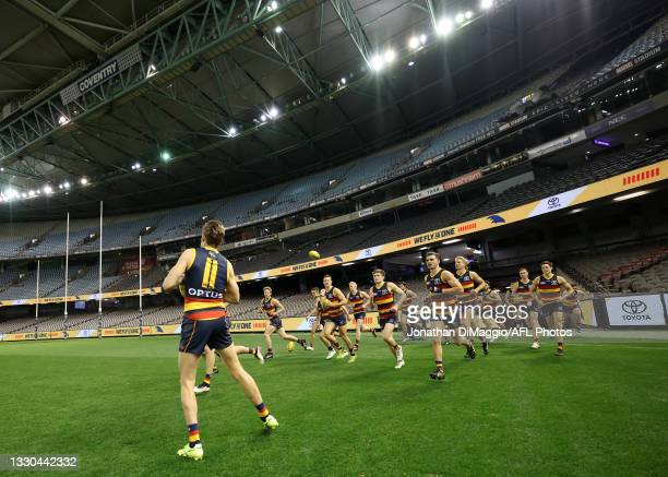 Paul Seedsman of the Crows leads out the team during the round 20 AFL match between Adelaide Crows and Hawthorn Hawks at Marvel Stadium on July 24,...