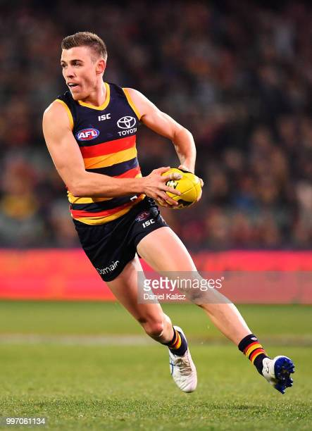 Paul Seedsman of the Crows runs with the ball during the round 17 AFL match between the Adelaide Crows and the Geelong Cats at Adelaide Oval on July...