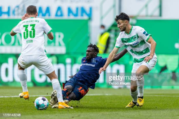 Paul Seguin of SpVgg Greuther Fuerth, Bakery Jatta of Hamburger SV and Maximilian Bauer of SpVgg Greuther Fuerth battle for the ball during the...