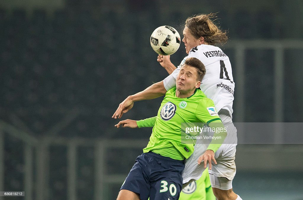 Paul Seguin of VfL Wolfsburg and Jannik Vestergaard of Borussia Moenchengladbach battle for the ball during the Bundesliga match between Borussia Moenchengladbach and VfL Wolfsburg at Borussia-Park on December 20, 2016 in Moenchengladbach, Germany.