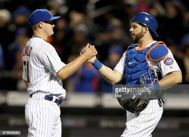 Paul Sewald and Kevin Plawecki of the New York Mets celebrate the 113 win over the Miami Marlins on May 6 2017 at Citi Field in the Flushing...