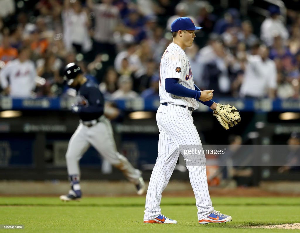 Paul Sewald #51 of the New York Mets reacts as Ender Inciarte #11 of the Atlanta Braves rounds third base after a two run home run in the seventh inning aon May 2, 2018 at Citi Field in the Flushing neighborhood of the Queens borough of New York City.
