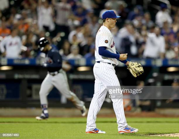 Paul Sewald of the New York Mets reacts as Ender Inciarte of the Atlanta Braves rounds third base after a two run home run in the seventh inning aon...