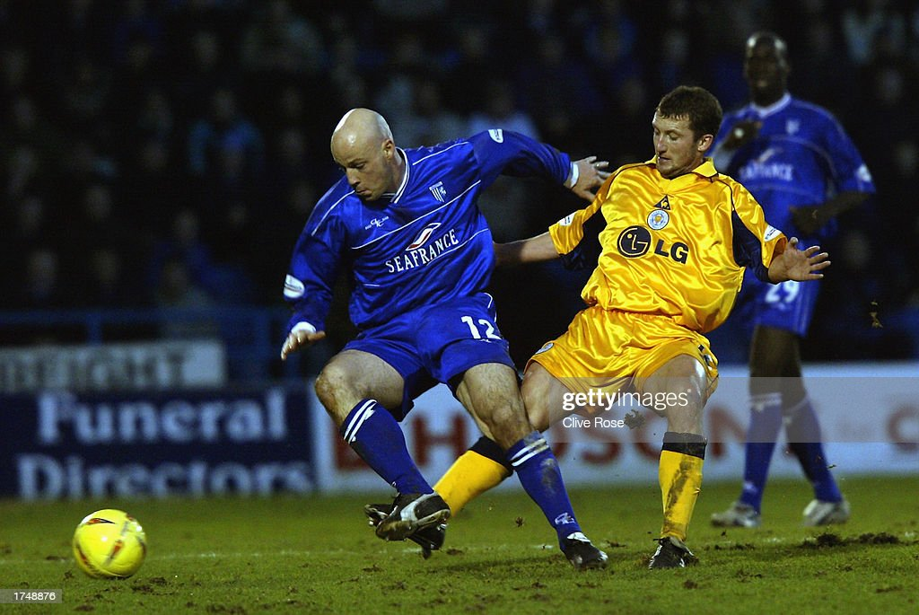 Paul Shaw of Gillingham is tackled by Billy McKinlay of Leicester City during the Nationwide League Division One match held on January 18, 2003 at the Priestfield Stadium, in Gillingham, England. Gillingham won the match 3-2.