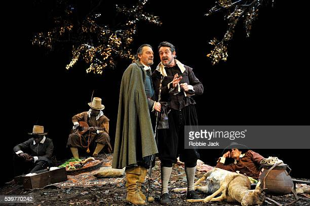 Paul Shelley as Duke Senior and Adrian Lukis as Jacques with artists of the company in William Shakespeare's As You Like It directed by Stephen Unwin...