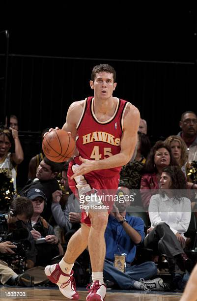 Paul Shirley of the Atlanta Hawks brings the ball upcourt during the preseason game against the Indiana Pacers on October 12 2002 at Conseco...