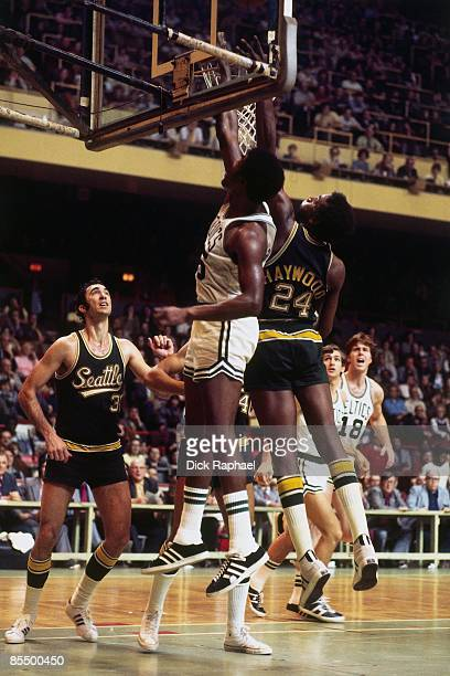 Paul Silas of the Boston Celtics and Spencer Haywood of the Seattle Supersonics battle for a rebound during a game played in 1973 at the Boston...