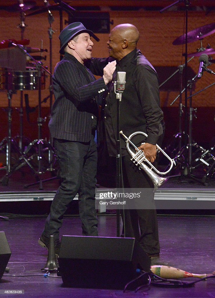 Paul Simon (L) and Hugh Masekela perform during the Hugh Masekela: Celebrating 75 Years concert at Rose Theater, Jazz at Lincoln Center on April 4, 2014 in New York City.
