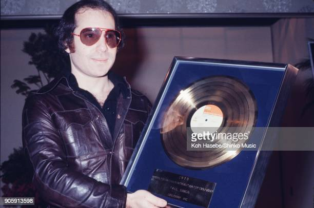 Paul Simon at press conference, with a plaque for Most Outstanding Contribution for CBS/SONY, April 1st 1974, Tokyo, Japan.