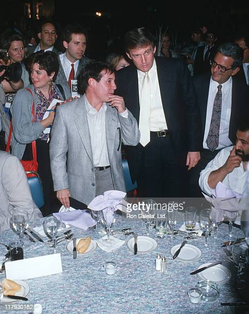 Paul Simon Donald Trump and guests during Mike Tyson vs Michael Spinks Fight at Trump Plaza June 27 1988 at Trump Plaza in Atlantic City New Jersey...