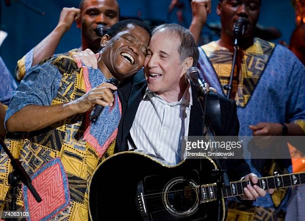 Paul Simon Joseph Shabalala and other members of Ladysmith Black Mambazo perform during the Library Of Congress Gershwin Prize For Popular Song Gala...