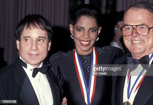 Paul Simon Melba Moore and Pierre Cossette during Ellis Island Medals of Honor Awards December 9 1990 at Waldorf Astoria Hotel in New York City New...