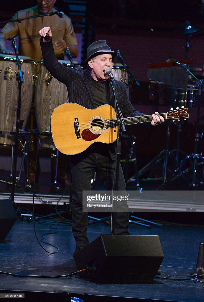 Paul Simon performs during the Hugh Masekela: Celebrating 75 Years concert at Rose Theater, Jazz at Lincoln Center on April 4, 2014 in New York City.