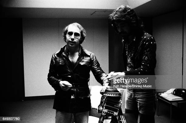 Paul Simon with a Japanese helmet and armor of souvenirs at the backstage at Nippon Budokan April 9th 1974