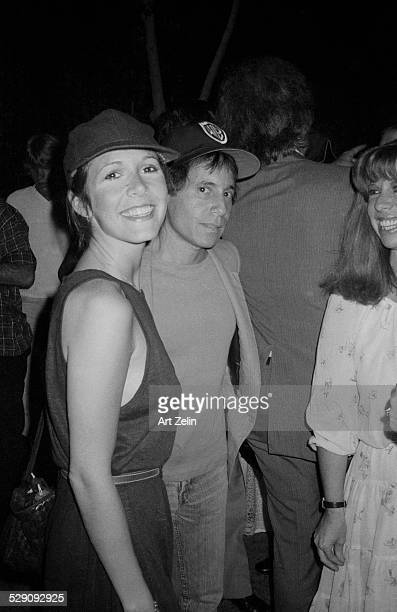 Paul Simon with Carry Fisher at a casual event circa 1960 New York