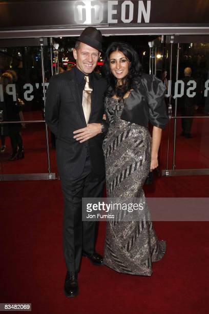 Paul Simonon and Serena Rees attend the world premiere of 'Quantum of Solace' at Odeon Leicester Square on October 29, 2008 in London, England.