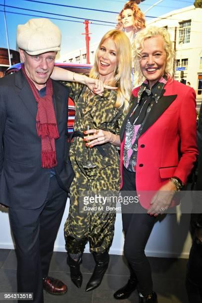"""Paul Simonon, Claudia Schiffer and Ellen von Unwerth attend a private view of photographer Ellen von Unwerth's exhibition """"Ladyland"""" at Opera Gallery..."""