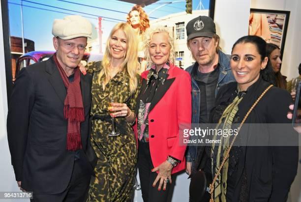 Paul Simonon, Claudia Schiffer, Ellen von Unwerth, Rhys Ifans and Serena Rees attend a private view of photographer Ellen von Unwerth's exhibition...