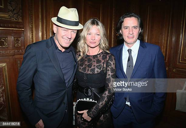 Paul Simonon Kate Moss and Don Donovan attend The Miu Miu Club And Croisiere 2017 Collection Presentation at Hotel De La Paiva on July 3 2016 in...