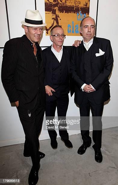 Paul Simonon Topper Headon and Mick Jones of The Clash attend the launch of 'Black Market Clash' an exhibition of personal memorabilia and items...