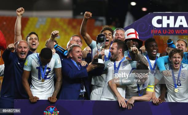 Paul Simpson manager of England and England players celebrate victory with the trophy after the FIFA U20 World Cup Korea Republic 2017 Final between...