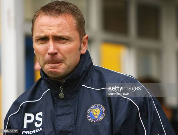 Paul Simpson manager of Shrewsbury Town looks on during the CocaCola Football League Two match between Bury and Shrewsbury Town at Gigg Lane on May...